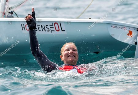 Stock Image of Danish Anne-Marie Rindom celebrates after winning the Laser Radial class during the  49th FX SAR Princesa Sofia trophy held at the Palma de Mallorca bay, Balearic Islands, Spain, 07 April 2018.