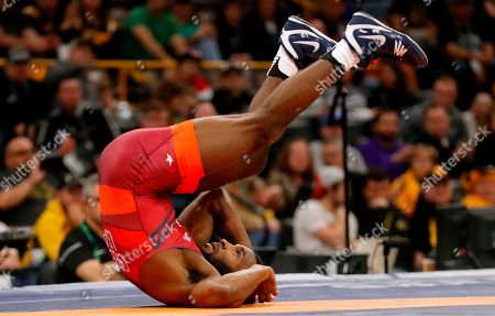 United State's James Green flips on the mat defeating India's Arun Kumar in their 70 kg match in the Freestyle Wrestling World Cup, in Iowa City, Iowa