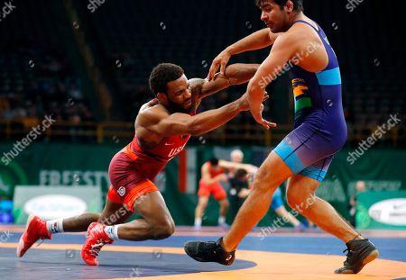 Jordan Burroughs, Vinod Kumar Omprakash. United State's Jordan Burroughs, left, pushes India's Vinod Kumar Omprakash out of bounds during their 74 kg match in the Freestyle Wrestling World Cup, in Iowa City, Iowa