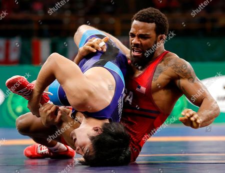 Jordan Burroughs, Yuhi Fujinami. United States' Jordan Burroughs, right, controls Japan's Yuhi Fujinami during their 74-kilogram match in the freestyle wrestling World Cup, in Iowa City, Iowa