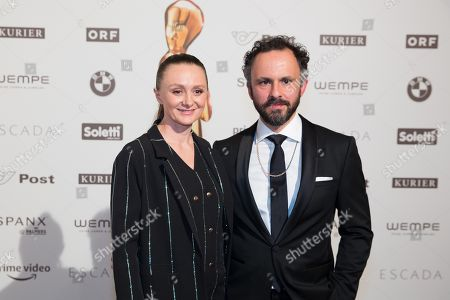 Austrian actress Gerti Drassl and her accompaniment pose on the red carpet ahead of the Romy Gala television award ceremony at the Hofburg palace in Vienna, Austria, 07 April 2018.