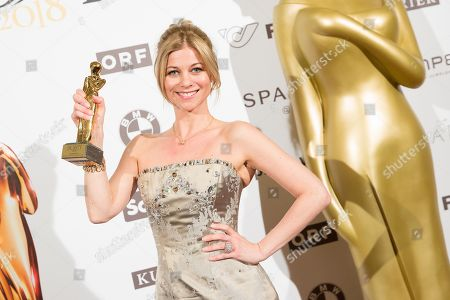 Austrian actress Hilde Dalik poses with her Romy award for most popular actress in a TV series during the Romy Gala television award ceremony at the Hofburg palace in Vienna, Austria, 07 April 2018. The Romy is a 24-carat gold-plated statuette with a weight of 2.9 kilograms.