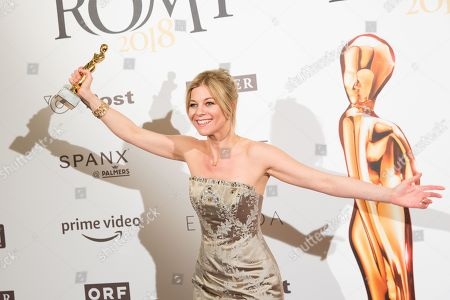Stock Picture of Austrian actress Hilde Dalik poses with her Romy award for most popular actress in a TV series during the Romy Gala television award ceremony at the Hofburg palace in Vienna, Austria, 07 April 2018. The Romy is a 24-carat gold-plated statuette with a weight of 2.9 kilograms.