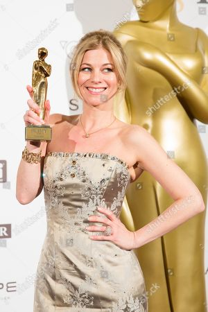 Stock Photo of Austrian actress Hilde Dalik poses with her Romy award for most popular actress in a TV series during the Romy Gala television award ceremony at the Hofburg palace in Vienna, Austria, 07 April 2018. The Romy is a 24-carat gold-plated statuette with a weight of 2.9 kilograms.