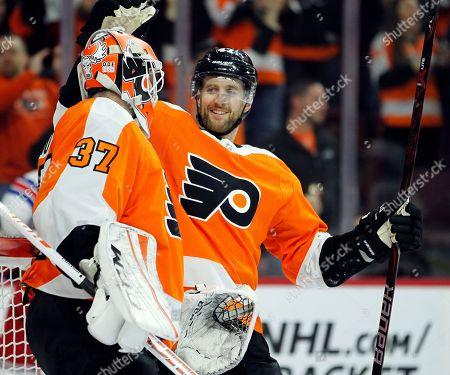 Brian Elliott, Andrew MacDonald. Philadelphia Flyers' Andrew MacDonald, right, congratulates goalie Brian Elliott at the end of an NHL hockey game against the New York Rangers, in Philadelphia. The Flyers won 5-0