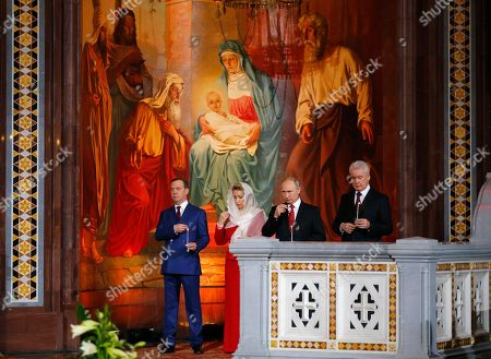 Vladimir Putin, Dmitry Medvedev, Svetlana Medvedeva, Sergei Sobyanin. Russian President Vladimir Putin, second right, Prime Minister Dmitry Medvedev, left, Medvedev's wife Svetlana, and Moscow's Mayor Sergei Sobyanin, right, attend the Easter service in the Christ the Savior Cathedral in Moscow, Russia, early . Eastern Orthodox churches, which observe the ancient Julian calendar, usually celebrate Easter later than Western churches