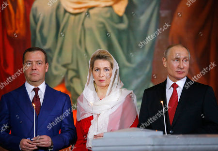 Vladimir Putin, Dmitry Medvedev, Svetlana Medvedeva. Russian President Vladimir Putin, right, Prime Minister Dmitry Medvedev, left, Medvedev's wife Svetlana attend the Easter service in the Christ the Savior Cathedral in Moscow, Russia, early . Eastern Orthodox churches, which observe the ancient Julian calendar, usually celebrate Easter later than Western churches