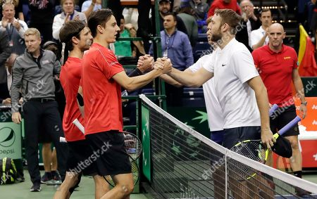 Jack Sock, Ryan Harrison, Sander Gille, Joran Vliegen, Jim Courier, Johan Van Herck. Belgiam's Sander Gille, left, and Joran Vliegen, congratulate Ryan Harrison and Jack Sock, right, of the United States, after Harrison and Sock won their Davis Cup quarterfinal doubles tennis match, in Nashville, Tenn. The match gave the United States the win in the series and advanced the team to the semifinals. At far left is American captain Jim Courier and at far right is Belgian captain Johan Van Herck