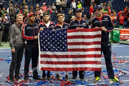 Jim Courier, the USA Davis Cup Team captain, (L) poses with the team (L-R) Steve Johnson, Jack Sock, Ryan Harrison, Sam Querrey, and John Isner celebrate their win in the World Group Davis Cup quarterfinals against Belgium in Nashville, Tennessee, USA, 07 April 2018. With the victory in the doubles match, USA won the round and advanced to the semi final round.