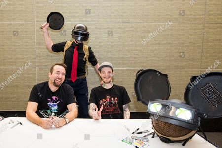 PUBG superfan poses with PUBG Creative Director Brendan Greene (PlayerUnknown), left, and deadmau5, right, following the PAX East Xbox Live Sessions at the Boston Convention and Exhibition Center on in Boston