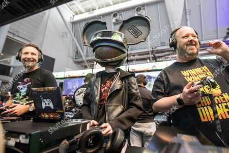 Stock Picture of PUBG Creative Director Brendan Greene (PlayerUnknown), from left, deadmau5 and GM of Games Marketing for Xbox Aaron Greenberg play PLAYERUNKNOWN'S BATTLEGROUNDS at the PAX East Xbox booth following the Xbox Live Sessions at the Boston Convention and Exhibition Center on in Boston