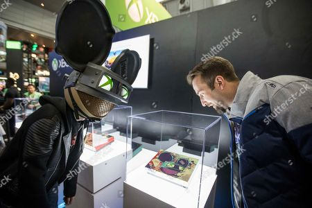 Stock Photo of Deadmau5 and PUBG Creative Director Brendan Greene (PlayerUnknown) look at the deadmau5 custom Xbox One X console at the PAX East Xbox booth following the Xbox Live Sessions at the Boston Convention and Exhibition Center on in Boston