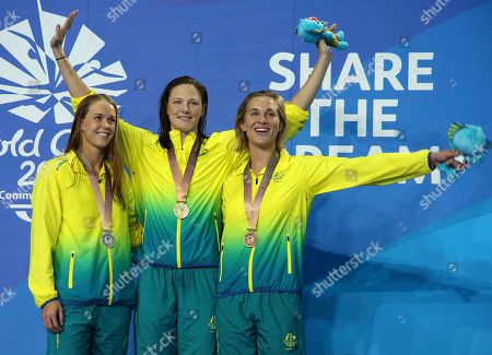 Cate Campbell, Holly Barrett, Madeline Groves. Women's 50m butterfly gold medalist Australia's Cate Campbell, centre, stands with compatriots Holly Barrett, silver, left, and Madeline Groves, bronze, on the podium at the Aquatic Centre during the 2018 Commonwealth Games on the Gold Coast, Australia
