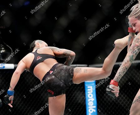 Bec Rawlings, Ashlee Evans-Smith. Ashlee Evans-Smith, left, kicks Bec Rawlings, of Australia, during the first round of a women's flyweight mixed martial arts bout at UFC 223, in New York. Evans-Smith won the fight