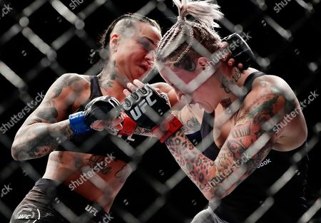 Bec Rawlings, Ashlee Evans-Smith. Ashlee Evans-Smith, left, punches Bec Rawlings, right, of Australia, during the second round women's flyweight mixed martial arts bout at UFC 223, in New York. Evans-Smith won the fight