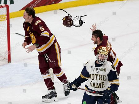 Nick Wolff, Justin Richards, Andrew Oglevie. Minnesota Duluth players Nick Wolff (5) and Justin Richards (19) celebrate while Notre Dame Andrew Oglevie (15) skates away at the end of the NCAA Frozen Four championship college hockey game, in St. Paul, Minn