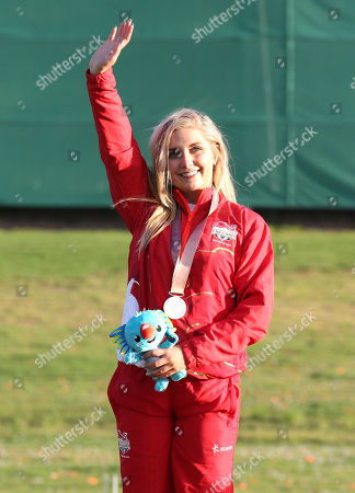 Amber Hill of England waves on the podium after winning the silver medal during the women's Skeet finals at the Belmont Shooting Centre during the 2018 Commonwealth Games in Brisbane, Australia