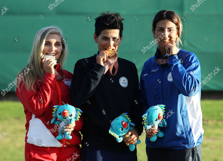 Silver medalist Amber Hill of England, left, gold medalist Andri Eleftheriou of Cyprus, center, and bronze medalist Panagiota Andreou of Cyprys, right, pose with their medals during the women's Skeet finals at the Belmont Shooting Centre during the 2018 Commonwealth Games in Brisbane, Australia