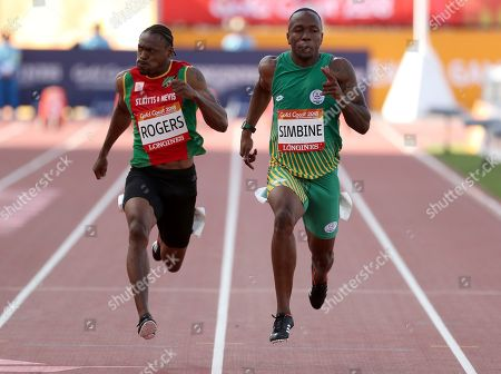 Akani Simbine, Jason Rogers. South Africa's Akani Simbine, right, leads Jason Rogers of Saint Kitts and Nevis in their heat of the men's 100m at the Carrara Stadium during the 2018 Commonwealth Games on the Gold Coast, Australia