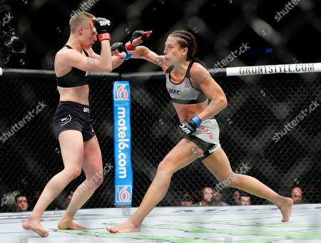 Rose Namajunas, Joanna Jedrzejczyk. Rose Namajunas deflects a punch by Poland's Joanna Jedrzejczyk, right, during the fourth round of a women's strawweight title bout at UFC 223, early, in New York. Namajunas won the fight