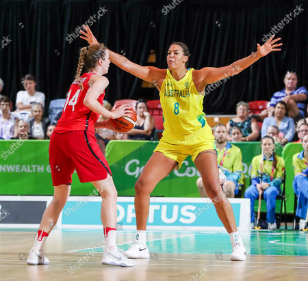Alex Kiss-Rusk of Canada looks for a way around Elizabeth Cambage of Australia during the Womens Preliminary Round Pool A, Australia v Canada of the XXI Commonwealth Games at the Townsville Entertainment Centre, Townsville, Australia, 08 April 2018.