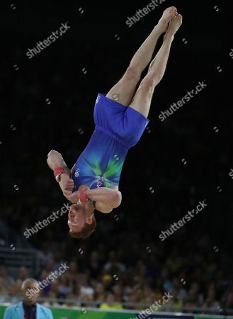 Stock Picture of Daniel Purvis of Scotland competes on the floor during the artistic gymnastics competition at the Commonwealth Games at Coomera Indoor Stadium on the Gold Coast, Australia