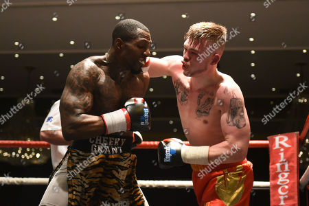 Darren Cordona (red shorts) draws with Duane Grant during a Boxing Show at the Thistle Hotel on 6th April 2018