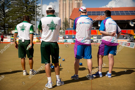 Hadyn Evans, Philip Jones, Ronald Duncan, Derek Oliver. From left, second Hadyn Evans and lead Philip Jones of Norfolk Island, and lead Ronald Duncan and second Derek Oliver of Scotland watch the action during their men's triples semifinal lawn bowling match at the Broadbeach Bowls Club during the 2018 Commonwealth Games on the Gold Coast, Australia, . The Norfolk team won the bronze medal with a 19-16 victory over Canada, securing the island's second medal ever at the Commonwealth Games