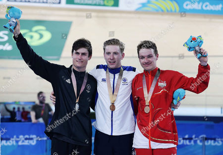 From left, Silver medalist Campbell Stewart from New Zealand, Gold medalist Mark Stewart from Scotland and bronze medalist Ethan Hayter pose during the medal ceremony for the Men's 40km. Points Race at the Anna Meares Velodrome during the 2018 Commonwealth Games in Brisbane, Australia
