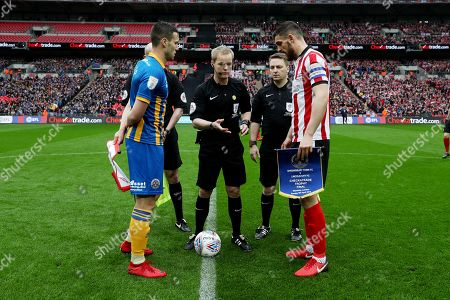 Matthew Sadler of Shrewsbury Town and Luke Waterfall of Lincoln City with referee Gavin Ward before the start of the match