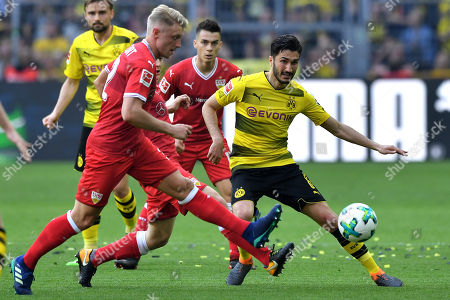 Dortmund's Nuri Sahin (R) in action against Stuttgart's Andreas Beck (L) during the German Bundesliga soccer match between Borussia Dortmund and VfB Stuttgart in Dortmund, Germany, 08 April 2018.