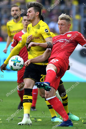Dortmund's Maximilian Philipp (L) in action against Stuttgart's Andreas Beck (R) during the German Bundesliga soccer match between Borussia Dortmund and VfB Stuttgart in Dortmund, Germany, 08 April 2018.