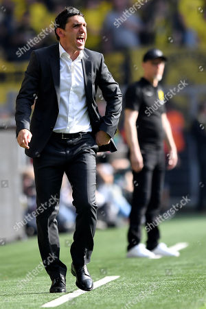 Stuttgart's head coach Tayfun Korkut reacts during the German Bundesliga soccer match between Borussia Dortmund and VfB Stuttgart in Dortmund, Germany, 08 April 2018.