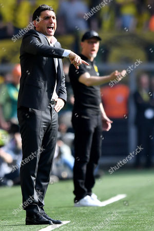 Stuttgart's head coach Tayfun Korkut (L) and Dortmund's head coach Peter Stoeger (R) react during the German Bundesliga soccer match between Borussia Dortmund and VfB Stuttgart in Dortmund, Germany, 08 April 2018.
