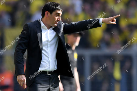 Stuttgart's head coach Tayfun Korkut gestures during the German Bundesliga soccer match between Borussia Dortmund and VfB Stuttgart in Dortmund, Germany, 08 April 2018.
