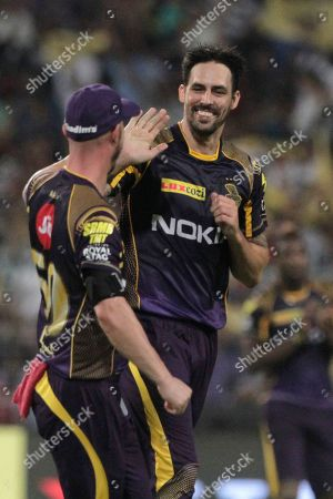 Mitchell Johnson, center, celebrates a wicket of Sarfaraz Khan of Royal Challengers Bangalore during VIVO IPL cricket T20 match in Kolkata, India