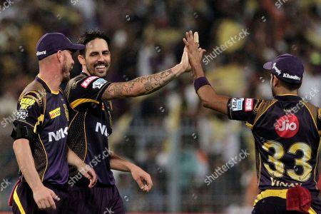 Stock Photo of Mitchell Johnson, center, celebrates the wicket of Sarfaraz Khan of Royal Challengers Bangalore during VIVO IPL cricket T20 match in Kolkata, India