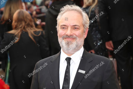 Sam Mendes poses for photographers upon arrival at the Olivier Awards in London