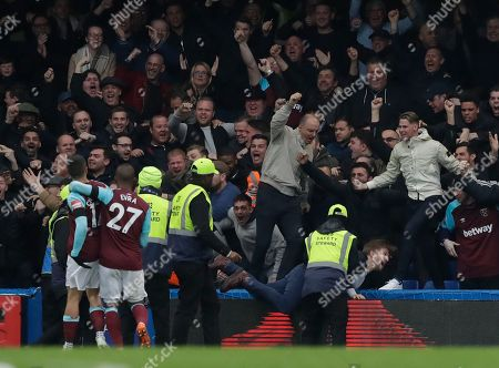Javier Hernandez, Patrice Evra. West Hams's Javier Hernandez, left, West Hams's Patrice Evra and West Hams's fans celebrate after scoring goal during the English Premier League soccer match between Chelsea and West Ham United at Stamford Bridge stadium in London