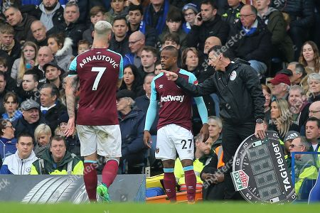 Patrice Evra of West Ham gets ready to be brought on as a  second half substitute during Chelsea vs West Ham United, Premier League Football at Stamford Bridge on 8th April 2018