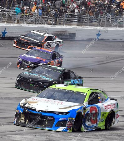 Austin Dillon, Denny Hamlin, Kasey Kahne, Reed Sorenson. Austin Dillon (3) and Denny Hamlin, second from top, head to pit road after wrecking in Turn 3 as Kasey Kahne (95) and Reed Sorenson, second from bottom, continue during a NASCAR Cup Series auto race in Fort Worth, Texas