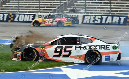 Kasey Kahne (95) crashes while coming out of Turn 4 as Matt DiBenedetto (32) heads into the front stretch during a NASCAR Cup Series auto race in Fort Worth, Texas