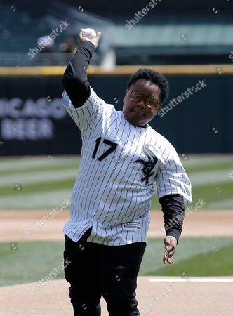 Shamon Brown, Jr., throws the ceremonial first pitch before a baseball game between the Detroit Tigers and the Chicago White Sox, in Chicago