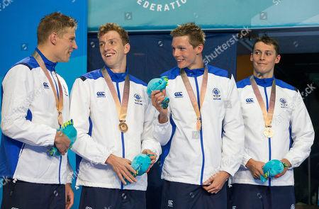 Stock Image of Day 4 Swimming Mens Relay Stephen Milne, Mark Szaranek, Duncan Scott, Dan Wallace. Bronze medalists