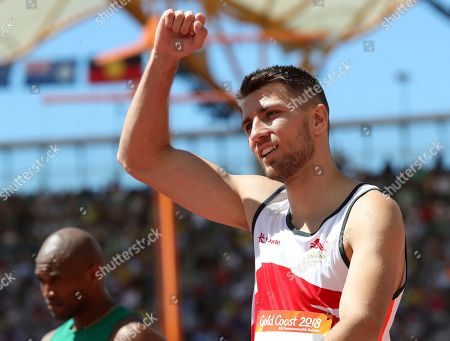 England's Andrew Pozzi reacts after winning his heat in the men's 110m hurdles at the Carrara Stadium during the 2018 Commonwealth Games on the Gold Coast, Australia