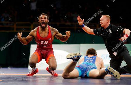 Jordan Burroughs, Gasjimurad Omarov. United States' Jordan Burroughs, left, celebrates after pinning Azerbaijan's Gasjimurad Omarov, right, in their 74 kg match in the Freestyle Wrestling World Cup, in Iowa City, Iowa