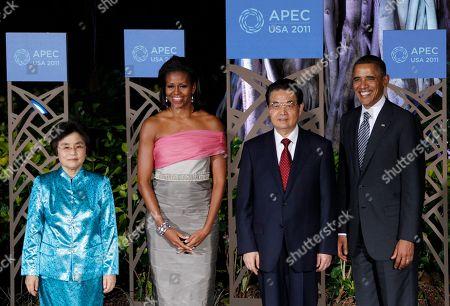 Barack Obama, Michelle Obama, Hu Jintao, Liu Yongqing. U.S. President Barack Obama and his wife Michelle greet Chinese President Hu Jintao and his wife Liu Yongqing, left, before their dinner at the APEC Summit in Honolulu