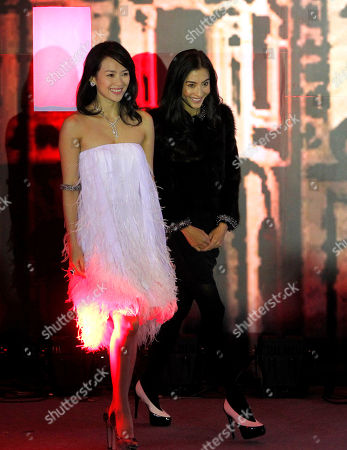 Cecilia Cheung Zhang Ziyi. Hong Kong actress Cecilia Cheung, right, and Chinese actress Zhang Ziyi arrive at a press conference marking the start of filming for the movie Dangerous Liaison by South Korean director Hur Jin-ho, unseen at a hotel in Beijing, China