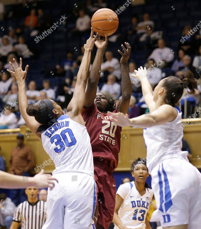 Amber Henson, Faith Suggs, Shakayla Thomas. Duke's Amber Henson (30) and Faith Suggs, right, defend against Florida State's Shakayla Thomas (20) during the second half of an NCAA college basketball game in Durham, N.C., . Florida State won 69-53