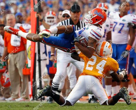 Carl Moore, Eric Gordon. Florida Gators wide receiver Carl Moore (9) hangs on to a pass as he is hit by Tennessee cornerback Eric Gordon (24) in the fourth quarter of an NCAA college football game, in Knoxville, Tenn. Florida won 31-17